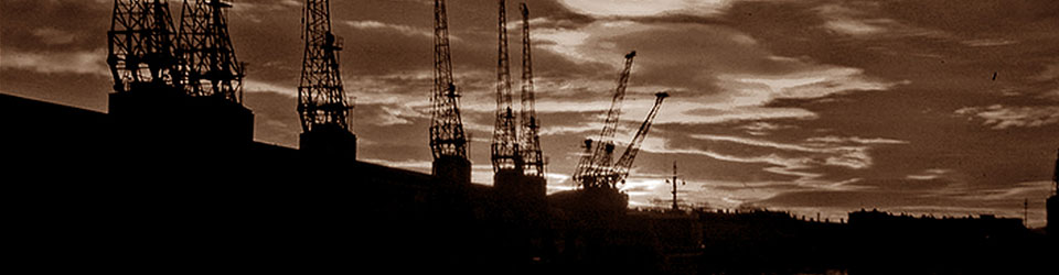 Black and white sepia image of Bristol docks at sunset