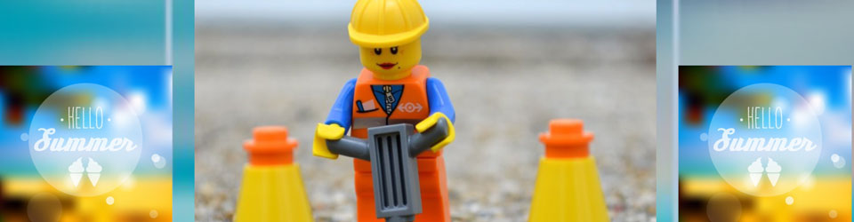 Lego figure digging up the road
