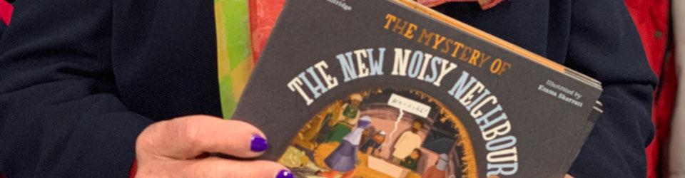 Close up of the Noisy Neighbour nativity story books