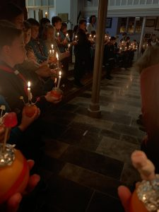A photo showing the lit Christingles in Christ Church.