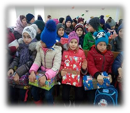An image of children from the local school at Pastor Misha's church for their Christmas service.