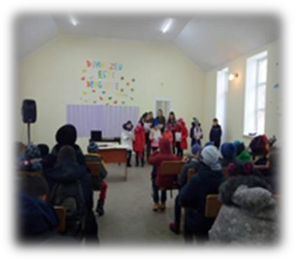 An image of people inside Pastor Misha's church building.