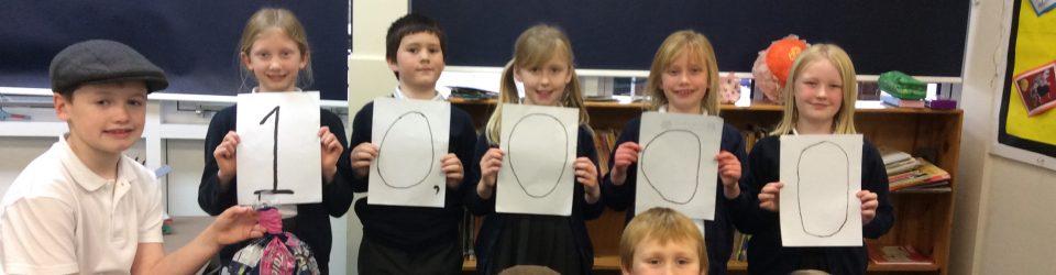 Junior SOUP leader & pupils at Bromley Heath Junior School holding a 10,000 bag target.